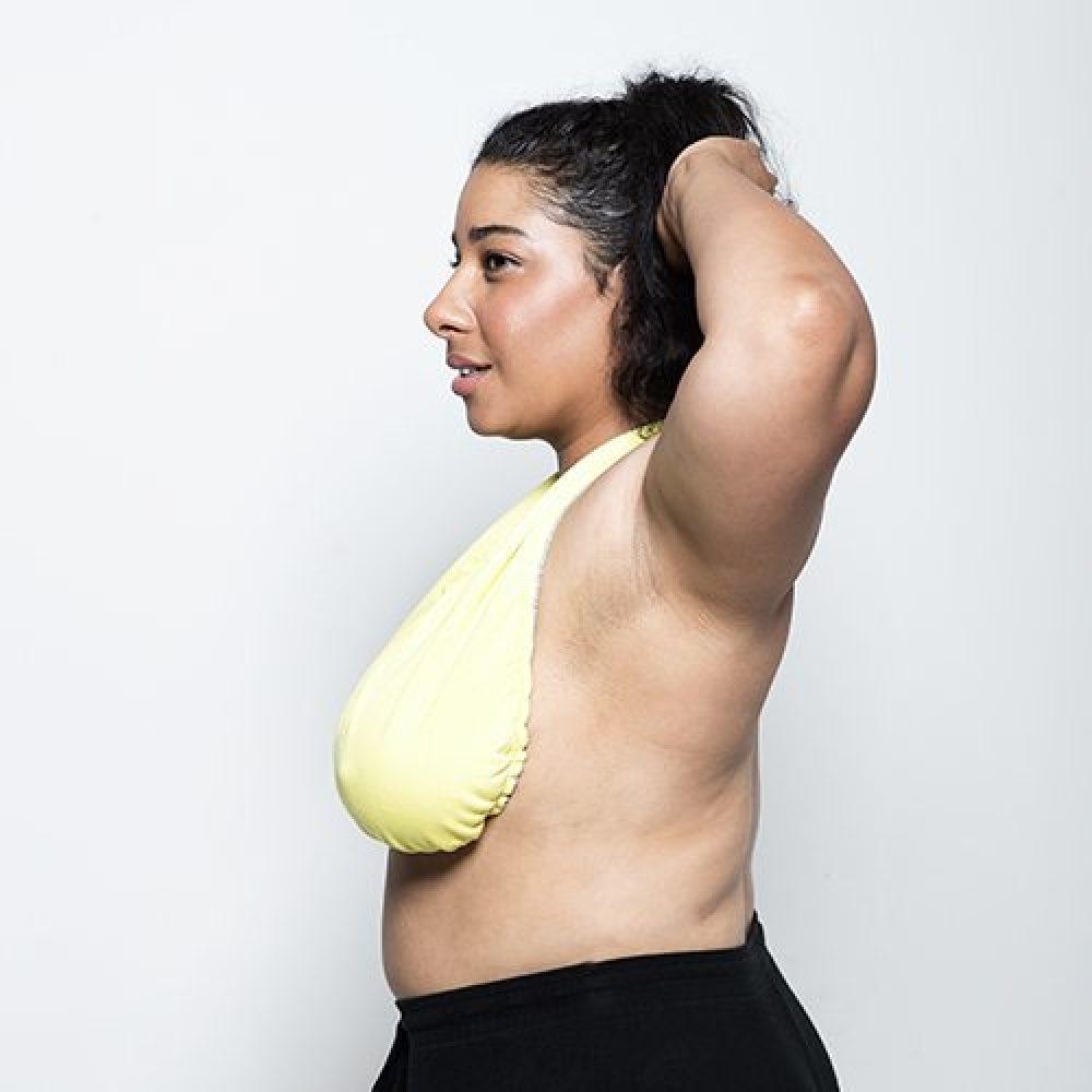 side view of woman model wearing yellow tata towel
